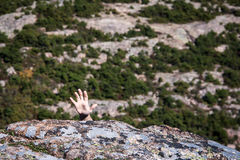 Hand reaching. Grip of a rock climber on cadillac mountain Royalty Free Stock Photo