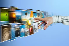Hand reaching images streaming from the deep Royalty Free Stock Photography