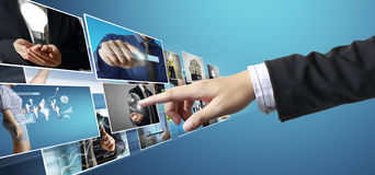Hand reaching images streaming from the deep Royalty Free Stock Photos