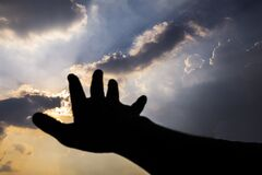 Free Hand Reaching Into The Sky.  Hand Reaching The Sky, Connection, Earth, Far Away, Hands. Hand Reaching For The Sky During Dusk Royalty Free Stock Photos - 176531738