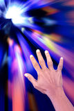 Hand reaching for light. Royalty Free Stock Photography