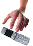 Hand reaching for mobile phone stock images