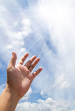 Hand reaching out. Adult hand reaching out towards the sky Royalty Free Stock Images