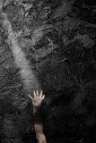 hand reaching out in the dark for help Stock Images