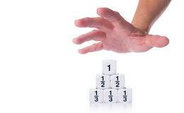 Hand reaching out for fraction dices stock image