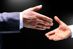 A hand is reaching out or grabbing for help from another hand Royalty Free Stock Photos
