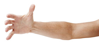 Hand Reaching Out Isolated. A hand and arm reaching out isolated on white royalty free stock image