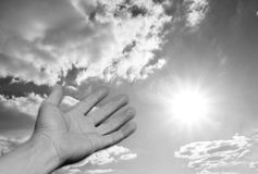Hand reaching out to the sun Royalty Free Stock Photography