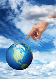 Hand reaching planet Earth Royalty Free Stock Images