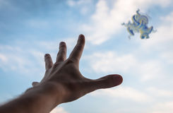 Hand reaching to the fractal figure in sky. Stock Photos