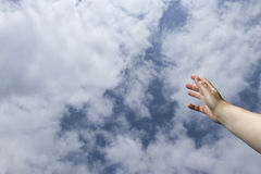 Hand reaching to heavens Royalty Free Stock Images
