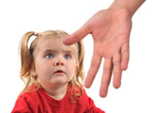 Hand Reaching to Scared Child on White. A hand is reaching down to a scared little child on a white isolated background for a helping or stranger concept royalty free stock photos