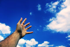 Hand reaching to sky Royalty Free Stock Photos