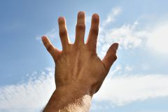 Hand reaching to the sky. Hand reaching towards the sky. Hand reaching for a help Royalty Free Stock Photo