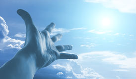 Hand reaching to sky. Hand of a man reaching to towards sky. Color toned image Stock Image