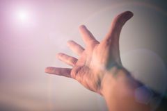 Hand reaching to sky. Hand of a man reaching to towards sky. Color toned image Stock Images