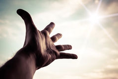 Hand reaching to towards sky. Hand of a man reaching to towards sky. Color toned image Royalty Free Stock Photography