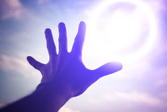 Hand reaching to towards sky. Hand of a man reaching to towards sky. Color toned image Stock Image