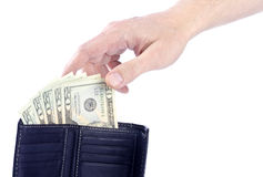Hand Reaching for Twenty US Dollar Bills Royalty Free Stock Photos
