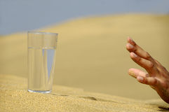 Hand reaching for water. Royalty Free Stock Photography