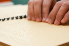 Hand reading in braille Royalty Free Stock Photos