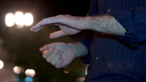 Hand ready to flip coin. Professional shot on BMCC RAW fith high dynamic range. You can use it e.g in your commercial video, business presentation, film and royalty free stock photo