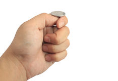 Hand ready to flip coin. Isolated on white royalty free stock photo