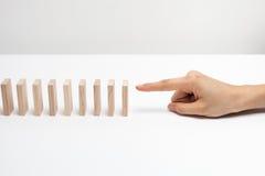Hand ready to push domino . Stock Photos