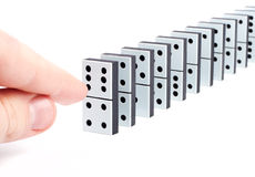 Hand ready to push domino pieces Royalty Free Stock Photo