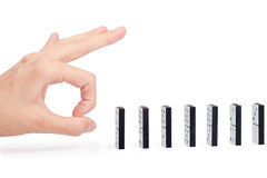 Hand ready to push domino pieces Royalty Free Stock Photos
