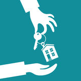 Hand real estate agent holding holds a key. Vector real estate concept in flat style - hand real estate agent holding holds a key with a tag in the form of homes vector illustration
