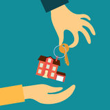 Hand real estate agent holding transmits a key. Vector real estate concept in flat style - hand real estate agent holding transmits a key with a tag in the form Royalty Free Stock Photo