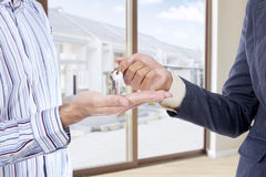 Hand receiving a new house key Royalty Free Stock Photography