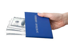 Hand with the record book and money.  Bribe. Royalty Free Stock Image