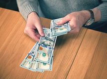 Hand recount dollars. the man counts the money Stock Image