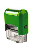 Hand rectangular automatic stamp, a brilliant green color. Stock Photography