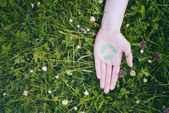 Hand with Recycle Symbol on Grass Royalty Free Stock Photo
