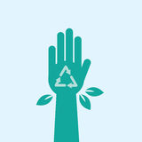 Hand Recycle Symbol. Green hand with recycle symbol and leaves Stock Images