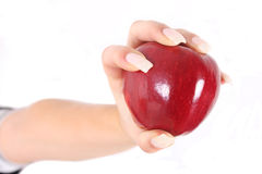 Hand and red apple Royalty Free Stock Photography