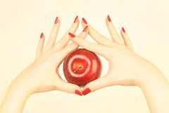 Hand with red apple Stock Image