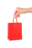 Hand with red bag Stock Images