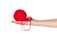 Hand with red ball. Woman hand with red ball of yarn for knitting isolated on white background Stock Photo