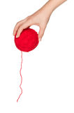 Hand with red ball. Woman hand with red ball of yarn for knitting isolated on white background Royalty Free Stock Photos