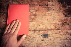 Hand on red book Royalty Free Stock Image