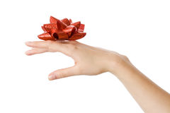 Hand and red bow Stock Images