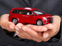 Hand with red car. Stock Photos