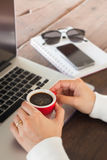 Hand on red cup of espresso Royalty Free Stock Images