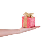 Hand with red gift Royalty Free Stock Photo