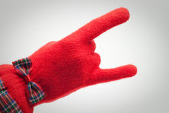 Hand in red glove over grey Royalty Free Stock Photography