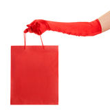 Hand in red gloves holding bag Royalty Free Stock Photos